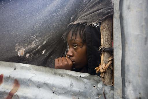 <div class='meta'><div class='origin-logo' data-origin='AP'></div><span class='caption-text' data-credit='Dieu Nalio Chery'>A girl watches as the authorities arrive to evacuate people from her house in Tabarre, Haiti, Monday, Oct. 3, 2016.</span></div>