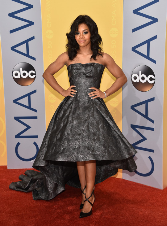 "<div class=""meta image-caption""><div class=""origin-logo origin-image none""><span>none</span></div><span class=""caption-text"">Gabby Douglas arrives at the 50th annual CMA Awards at the Bridgestone Arena on Wednesday, Nov. 2, 2016, in Nashville, Tenn. (Evan Agostini/Invision/AP)</span></div>"