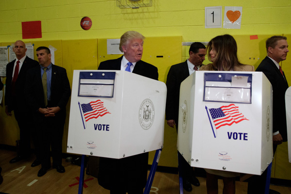 <div class='meta'><div class='origin-logo' data-origin='none'></div><span class='caption-text' data-credit='Evan Vucci/AP Photo'>Republican presidential candidate Donald Trump and his wife Melania cast their ballots at PS-59, Tuesday, Nov. 8, 2016, in New York.</span></div>