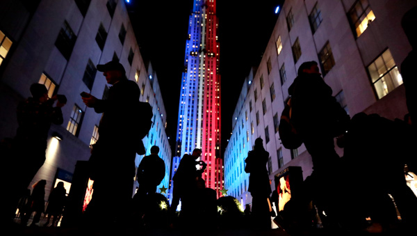 <div class='meta'><div class='origin-logo' data-origin='none'></div><span class='caption-text' data-credit='Julio Cortez/AP Photo'>People stop for photographs in front of an Rockefeller Center, which is illuminated in patriotic lights during an Election Day gathering, Tuesday, Nov. 8, 2016, in New York.</span></div>