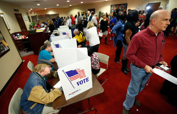 <div class='meta'><div class='origin-logo' data-origin='none'></div><span class='caption-text' data-credit='Rogelio V. Solis/AP Photo'>Last minute voters rush to cast their ballots on Election Day at the Christ United Methodist Church precinct in north Jackson, Miss., Tuesday, Nov. 8, 2016.</span></div>
