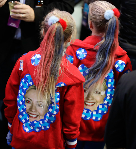 <div class='meta'><div class='origin-logo' data-origin='none'></div><span class='caption-text' data-credit='David Goldman/AP Photo'>Girls wear jackets with the image of Hillary Clinton during Democratic presidential nominee's election night rally in the Jacob Javits Center glass enclosed lobby in New York.</span></div>