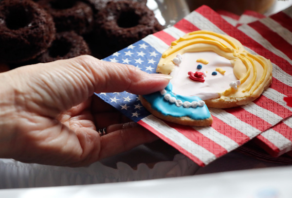 <div class='meta'><div class='origin-logo' data-origin='none'></div><span class='caption-text' data-credit='Eugene Hoshiko/AP Photo'>A guest picks up a cookie depicting Hillary Clinton prior to watch a live broadcasting of the 2016 U.S. Presidential Election results at U.S. Ambassador's residence in Tokyo.</span></div>
