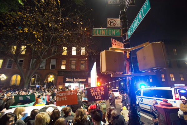 "<div class=""meta image-caption""><div class=""origin-logo origin-image none""><span>none</span></div><span class=""caption-text"">Residents of Carroll Gardens watch election results during an election night party for Hillary Clinton at the intersection of President and Clinton streets in Brooklyn. (Mark Lennihan/AP Photo)</span></div>"