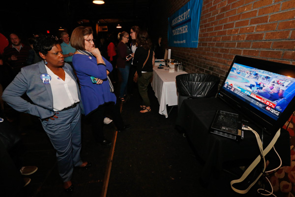 <div class='meta'><div class='origin-logo' data-origin='none'></div><span class='caption-text' data-credit='Rogelio V. Solis/AP'>Democratic presidential candidate Hillary Clinton watch results come in during a state Democratic Party election watch party in Jackson, Miss., Tuesday, Nov. 8, 2016.</span></div>