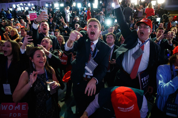 <div class='meta'><div class='origin-logo' data-origin='none'></div><span class='caption-text' data-credit='Evan Vucci/AP'>Supporters of Republican presidential candidate Donald Trump cheer as they watch election returns during an election night rally, Tuesday, Nov. 8, 2016, in New York.</span></div>