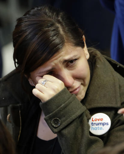 "<div class=""meta image-caption""><div class=""origin-logo origin-image ap""><span>AP</span></div><span class=""caption-text"">A woman cries during Democratic presidential nominee Hillary Clinton's election night rally in the Jacob Javits Center glass enclosed lobby in New York. (AP Photo/David Goldman)</span></div>"