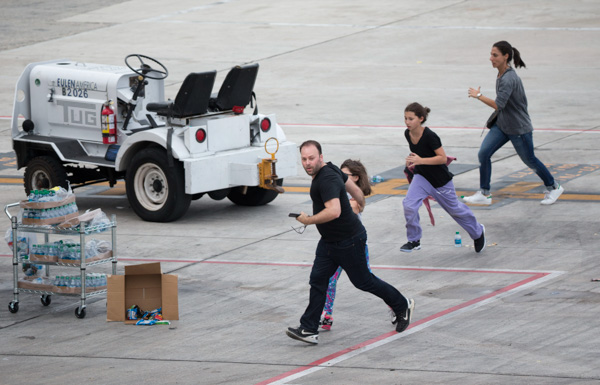 <div class='meta'><div class='origin-logo' data-origin='none'></div><span class='caption-text' data-credit='Wilfredo Lee/AP'>People run on the tarmac at Fort Lauderdale-Hollywood International Airport, Friday, Jan. 6, 2017, after a shooter opened fire inside a terminal of the airport.</span></div>