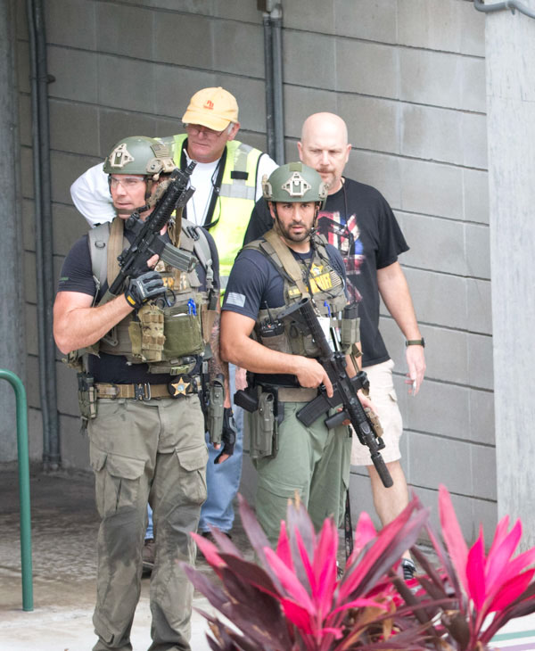 <div class='meta'><div class='origin-logo' data-origin='none'></div><span class='caption-text' data-credit='Wilfredo Lee/AP Photo'>Law enforcement personnel are shown outside a garage area at Fort Lauderdale-Hollywood International Airport, Friday, Jan. 6, 2017.</span></div>