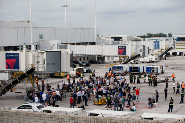 "<div class=""meta image-caption""><div class=""origin-logo origin-image none""><span>none</span></div><span class=""caption-text"">People stand on the tarmac at the Fort Lauderdale-Hollywood International Airport after a shooter opened fire inside a terminal of the airport. (Wilfredo Lee/AP)</span></div>"