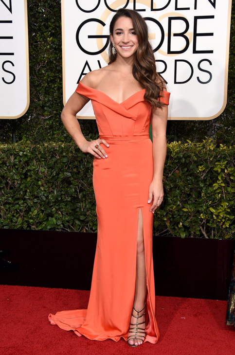 <div class='meta'><div class='origin-logo' data-origin='none'></div><span class='caption-text' data-credit='Jordan Strauss/Invision/AP'>Aly Raisman arrives at the 74th annual Golden Globe Awards at the Beverly Hilton Hotel on Sunday, Jan. 8, 2017, in Beverly Hills, Calif.</span></div>
