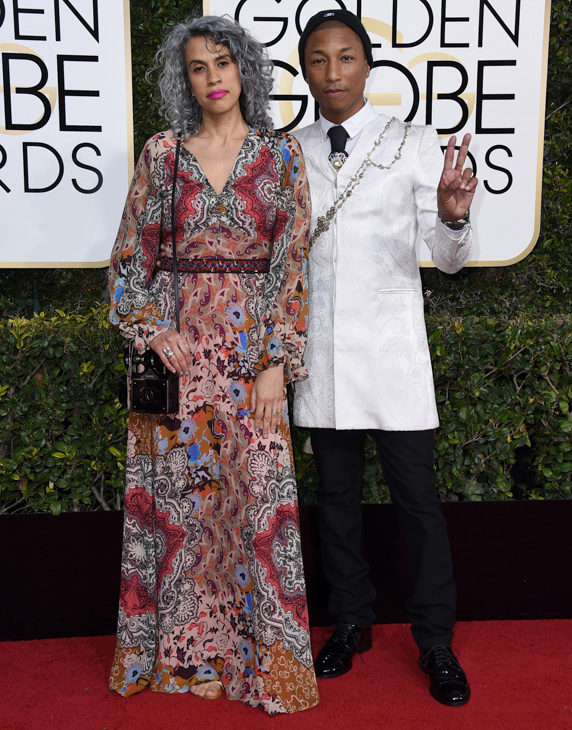 <div class='meta'><div class='origin-logo' data-origin='none'></div><span class='caption-text' data-credit='Jordan Strauss/Invision/AP'>Mimi Valdes, left, and Pharrell Williams arrive at the 74th annual Golden Globe Awards at the Beverly Hilton Hotel on Sunday, Jan. 8, 2017, in Beverly Hills, Calif.</span></div>