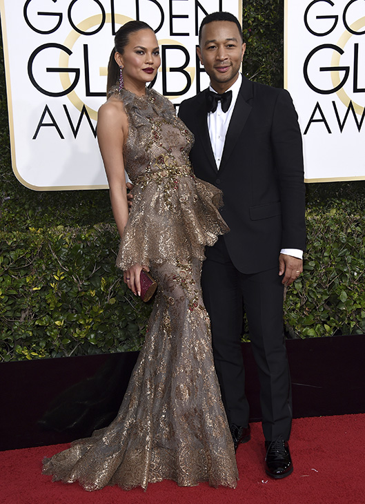 <div class='meta'><div class='origin-logo' data-origin='none'></div><span class='caption-text' data-credit='Jordan Strauss/Invision/AP'>Chrissy Teigen, left, and John Legend arrive at the 74th annual Golden Globe Awards at the Beverly Hilton Hotel on Sunday, Jan. 8, 2017, in Beverly Hills, Calif.</span></div>