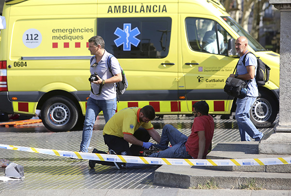 <div class='meta'><div class='origin-logo' data-origin='none'></div><span class='caption-text' data-credit='AP Photo/Oriol Duran'>An injured person is treated in Barcelona after a white van jumped the sidewalk in the historic Las Ramblas district, crashing into a summer crowd of residents and tourists.</span></div>