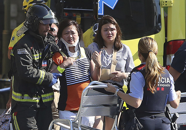 "<div class=""meta image-caption""><div class=""origin-logo origin-image none""><span>none</span></div><span class=""caption-text"">Injured people are treated in Barcelona after a white van jumped the sidewalk in the historic Las Ramblas district, crashing into a summer crowd of residents. (AP Photo/Oriol Duran)</span></div>"
