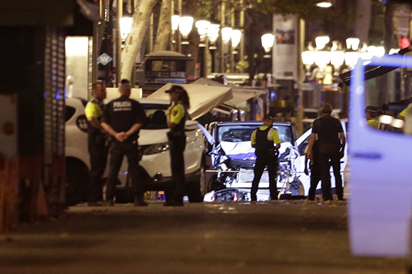 <div class='meta'><div class='origin-logo' data-origin='none'></div><span class='caption-text' data-credit='Manu Fernandez/AP'>Police officers stand next to the van involved in a terrorist attack in Las Ramblas in Barcelona, Spain, Thursday, Aug. 17, 2017.</span></div>