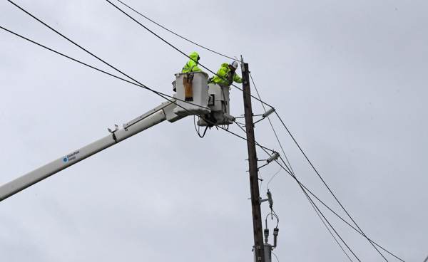 "<div class=""meta image-caption""><div class=""origin-logo origin-image none""><span>none</span></div><span class=""caption-text"">Power company workers repair damaged power lines damages from Hurricane Harvey Saturday, Aug. 26, 2017, in Katy, Texas. (David J. Phillip/AP Photo)</span></div>"