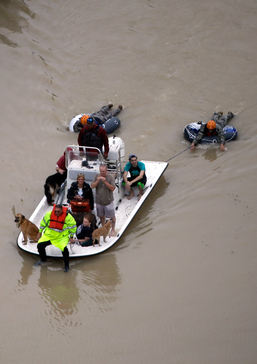 "<div class=""meta image-caption""><div class=""origin-logo origin-image none""><span>none</span></div><span class=""caption-text"">Evacuees make their way though floodwaters near the Addicks Reservoir as floodwaters from Hurricane Harvey rise Tuesday, Aug. 29, 2017, in Houston. (David J. Phillip/AP Photo)</span></div>"