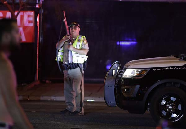 <div class='meta'><div class='origin-logo' data-origin='AP'></div><span class='caption-text' data-credit='AP'>A police officer stands at the scene of a shooting along the Las Vegas Strip, Monday, Oct. 2, 2017, in Las Vegas. (AP Photo/John Locher)</span></div>