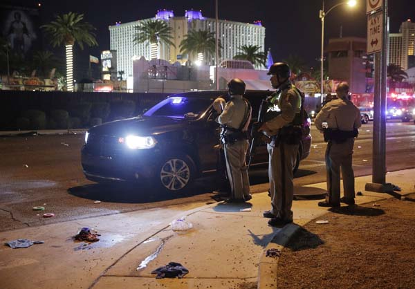 <div class='meta'><div class='origin-logo' data-origin='AP'></div><span class='caption-text' data-credit='AP'>Las Vegas Police stand at the scene of a shooting along the Las Vegas Strip, Monday, Oct. 2, 2017, in Las Vegas. (AP Photo/John Locher)</span></div>
