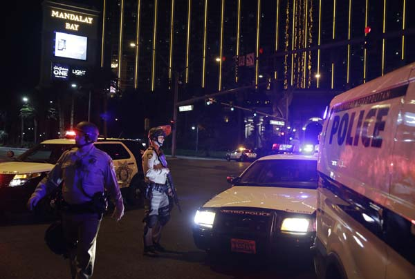 <div class='meta'><div class='origin-logo' data-origin='AP'></div><span class='caption-text' data-credit='AP'>Police officers stand along the Las Vegas Strip outside the Mandalay Bay resort and casino (AP Photo/John Locher)</span></div>