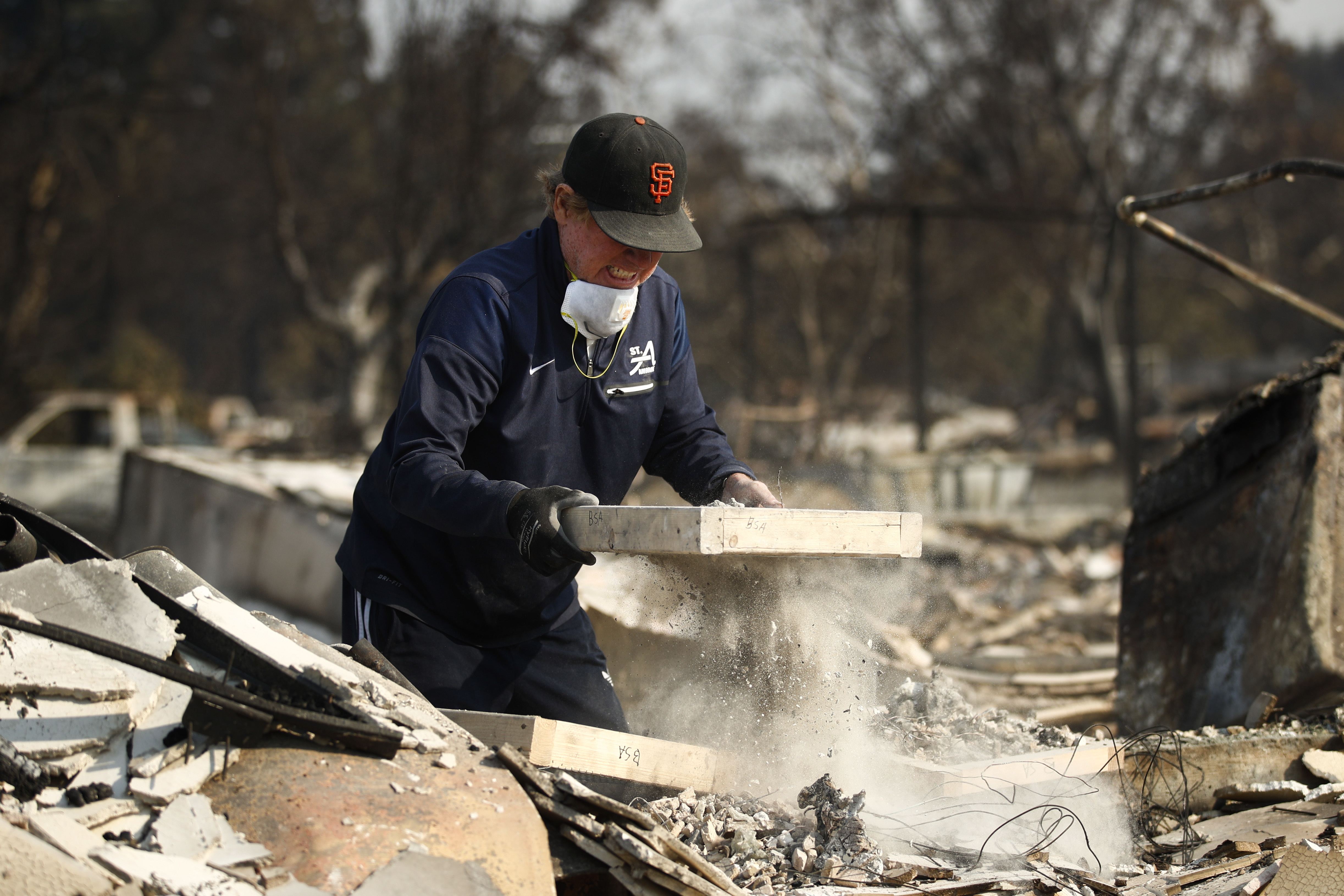 <div class='meta'><div class='origin-logo' data-origin='none'></div><span class='caption-text' data-credit='Jae C. Hong/AP Photo'>Ed Curzon sifts through the rubble of his Coffey Park house. ''This is our home. This is where we grew up,'' he said. &#34;We will rebuild here.&#34;</span></div>