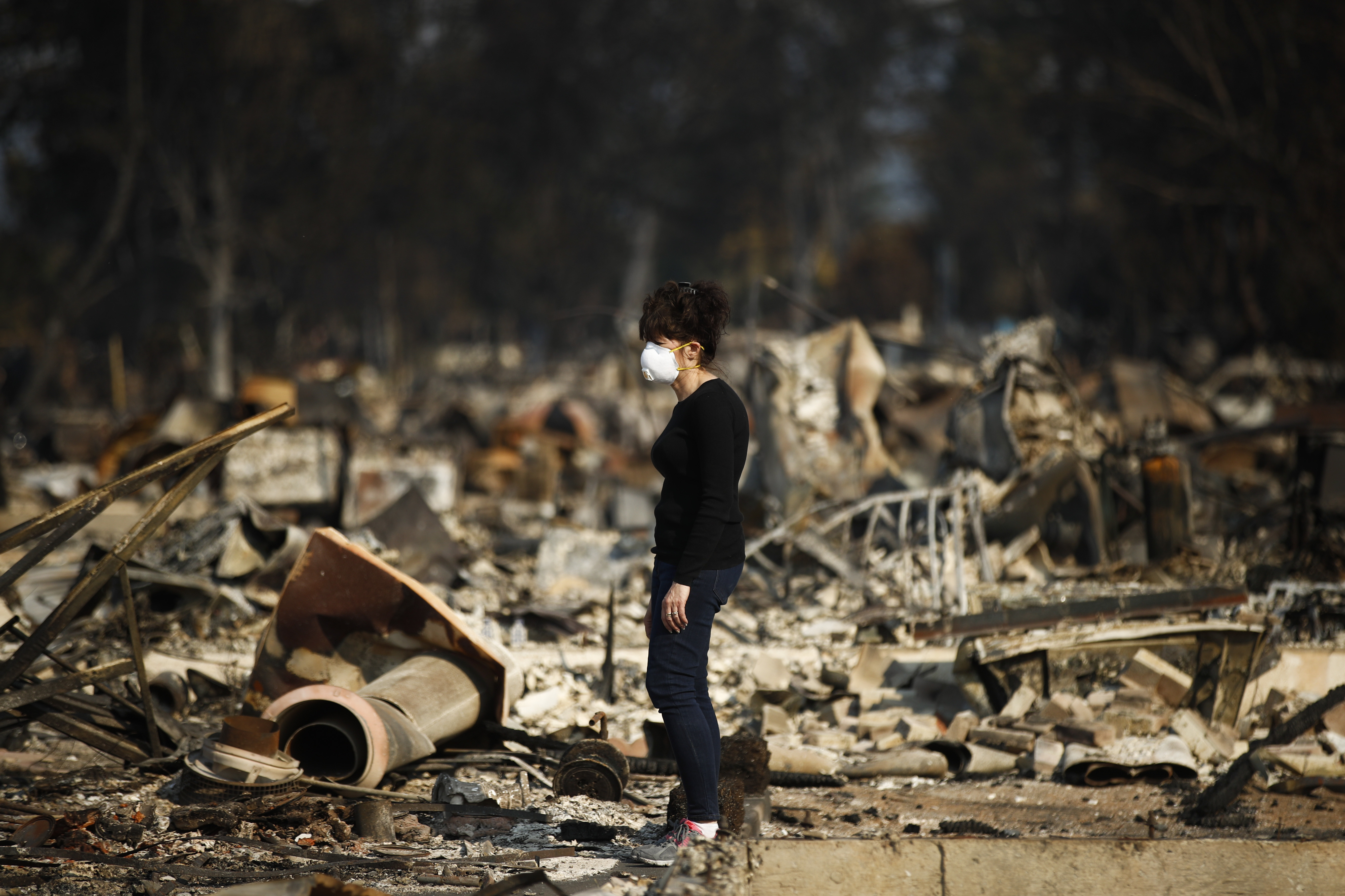 <div class='meta'><div class='origin-logo' data-origin='none'></div><span class='caption-text' data-credit='Jae C. Hong/AP Photo'>Karen Curzon stands in what remains of her home, which was destroyed by a wildfire in the Coffey Park neighborhood, Sunday, Oct. 15, 2017, in Santa Rosa, Calif.</span></div>