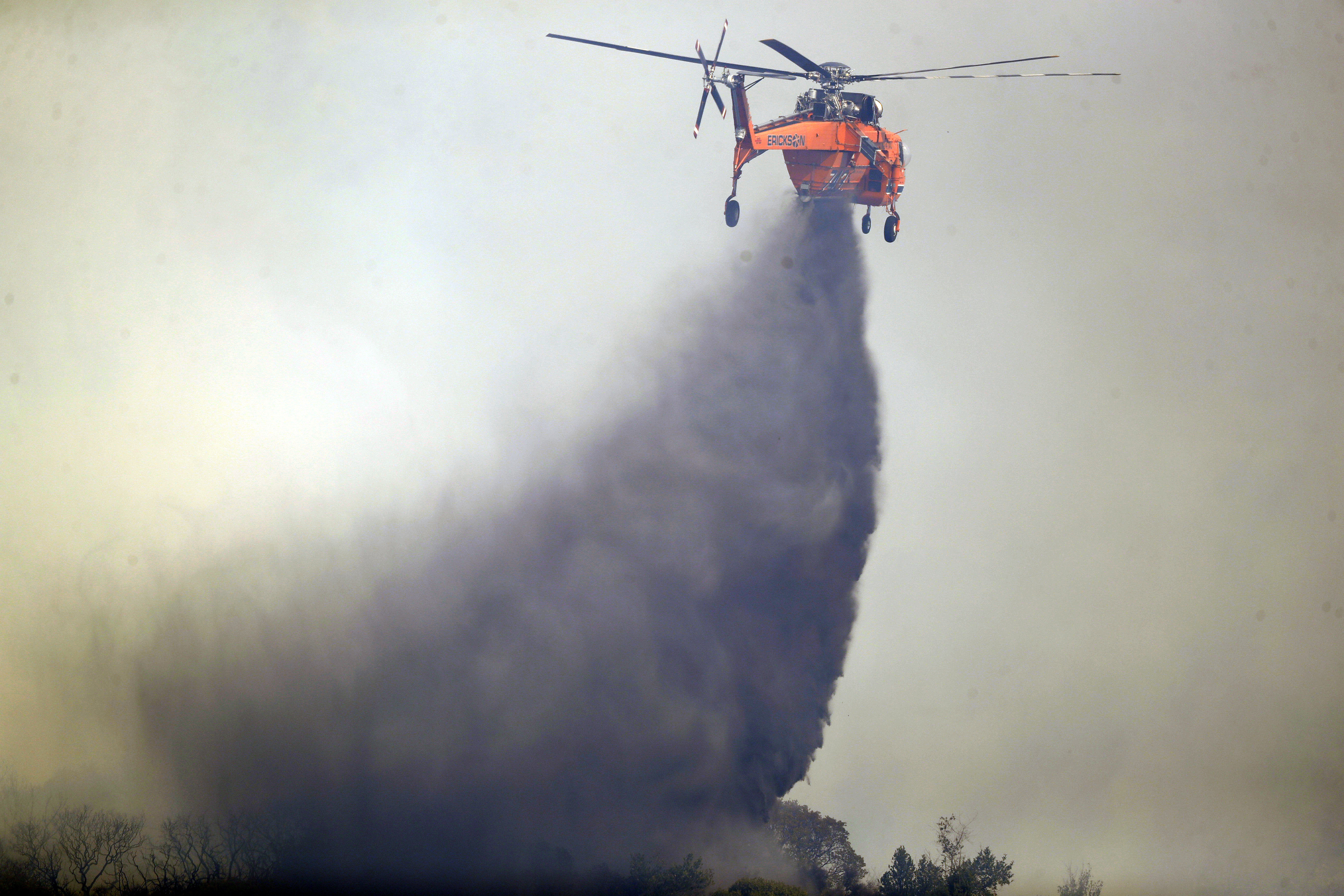 <div class='meta'><div class='origin-logo' data-origin='none'></div><span class='caption-text' data-credit='Marcio Jose Sanchez/AP Photo'>A helicopter drops water onto a burning wildfire, Sunday, Oct. 15, 2017, in Oakville, Calif.</span></div>