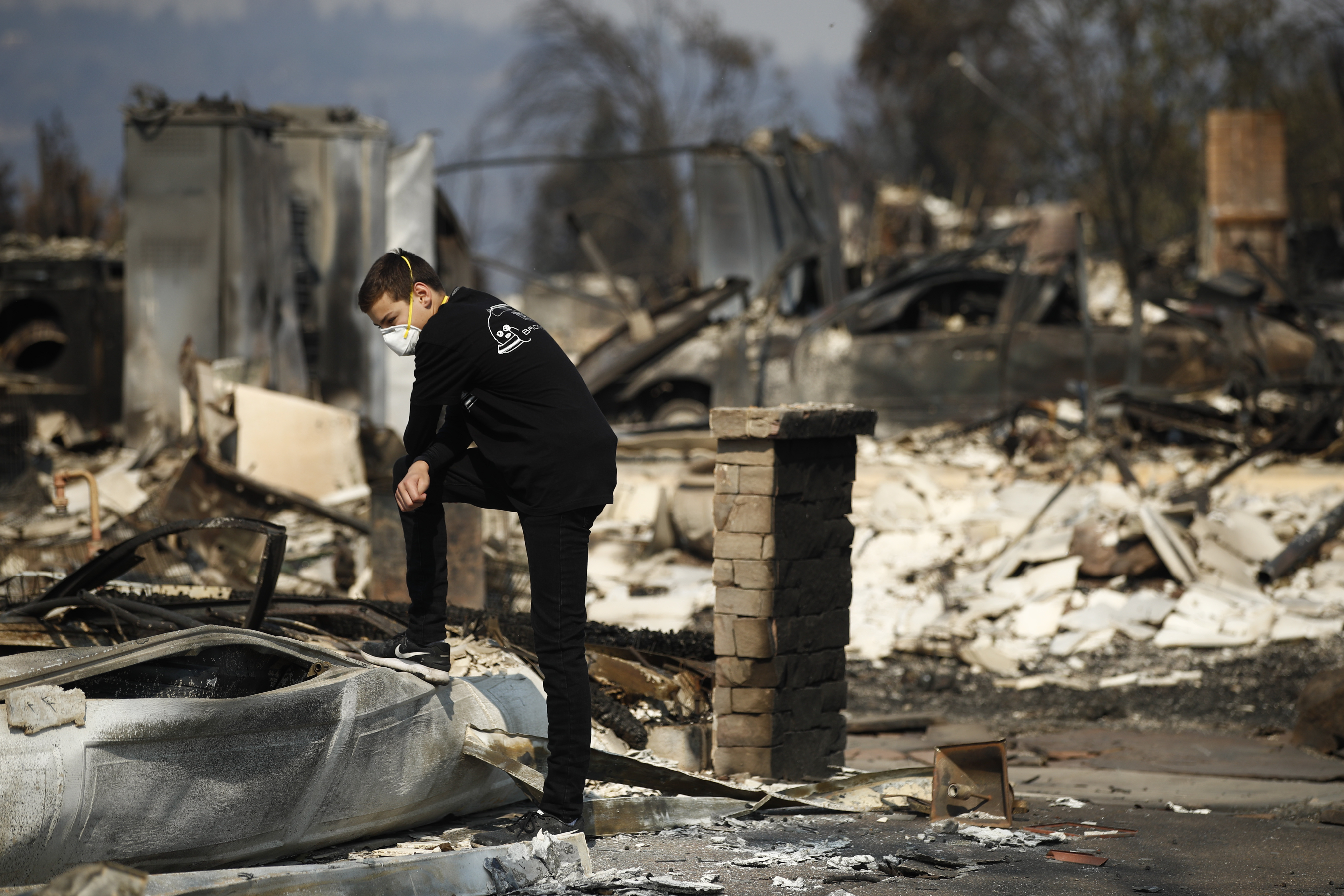 <div class='meta'><div class='origin-logo' data-origin='none'></div><span class='caption-text' data-credit='Jae C. Hong/AP Photo'>Benjamin Lasker, 16, pauses while looking at what remains of his home after a wildfire swept through Sunday, Oct. 15, 2017, in Santa Rosa, Calif.</span></div>
