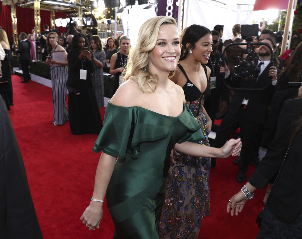 <div class='meta'><div class='origin-logo' data-origin='AP'></div><span class='caption-text' data-credit='Matt Sayles/Invision/AP'>Reese Witherspoon, left, and Gina Rodriguez arrive at the 24th annual Screen Actors Guild Awards at the Shrine Auditorium & Expo Hall on Sunday, Jan. 21, 2018, in Los Angeles.</span></div>