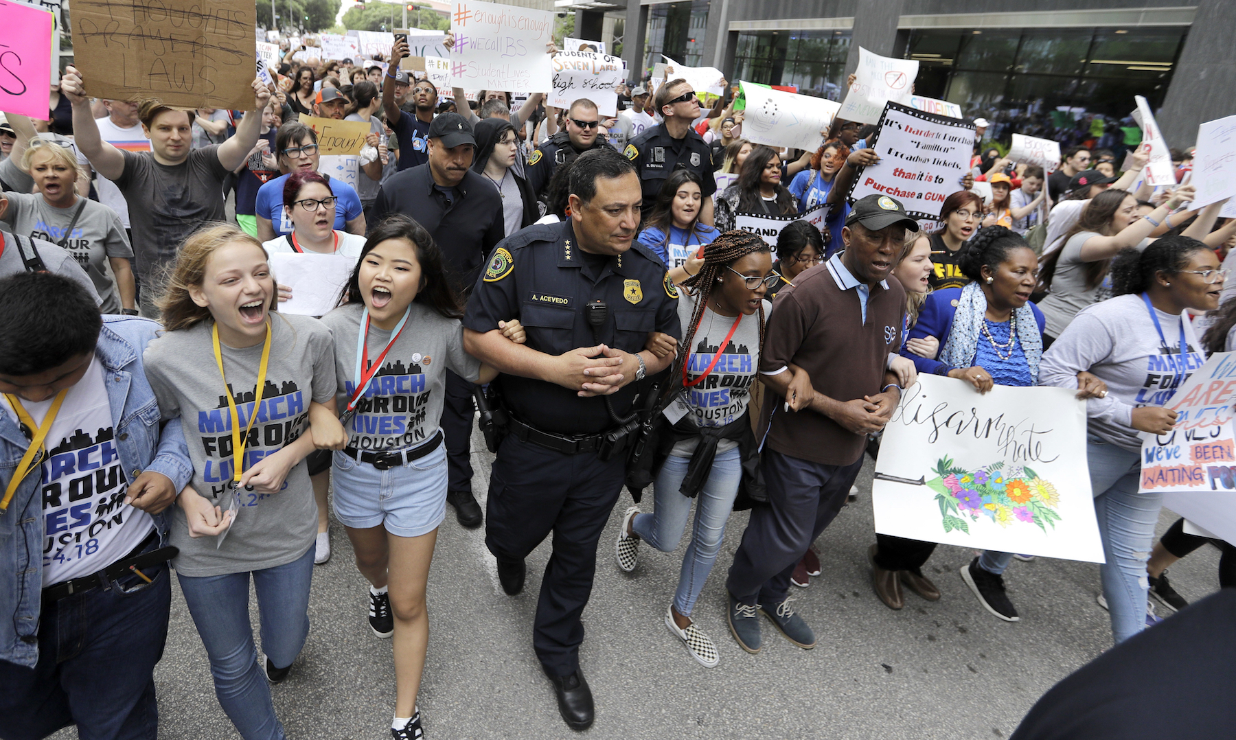 <div class='meta'><div class='origin-logo' data-origin='AP'></div><span class='caption-text' data-credit='AP Photo/David J. Phillip'>Houston Police Chief Art Acevedo, Houston Mayor Sylvester Turner, and Rep. Sheila Jackson Lee, D-Texas, join demonstrators during a March for Our Lives protest in Houston.</span></div>