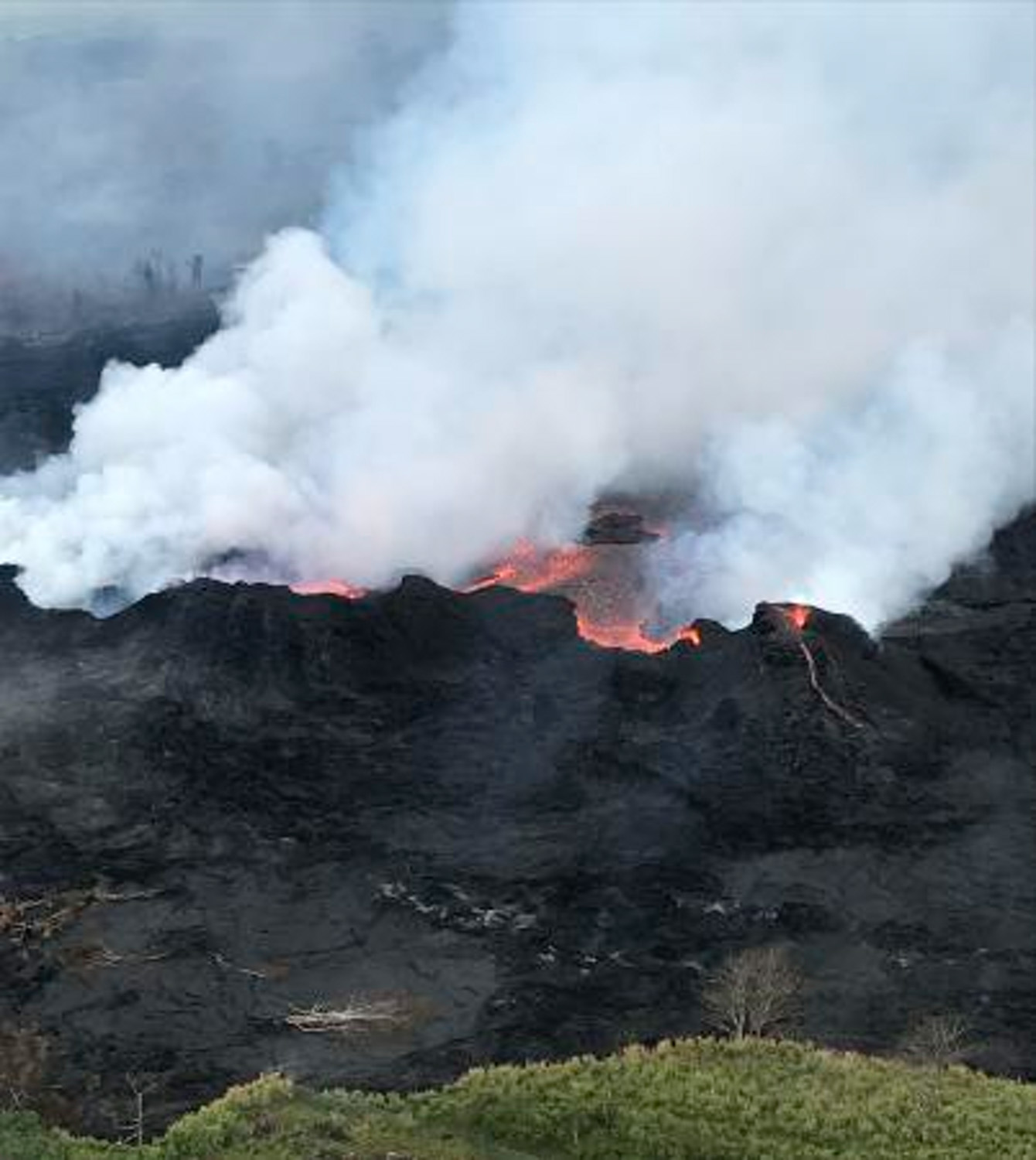 <div class='meta'><div class='origin-logo' data-origin='none'></div><span class='caption-text' data-credit='U.S. Geological Survey via AP'>An aerial view of fissure 22 looking toward the south, as Kilauea Volcano continues its eruption cycle near Pahoa on the island of Kilauea, Hawaii.</span></div>