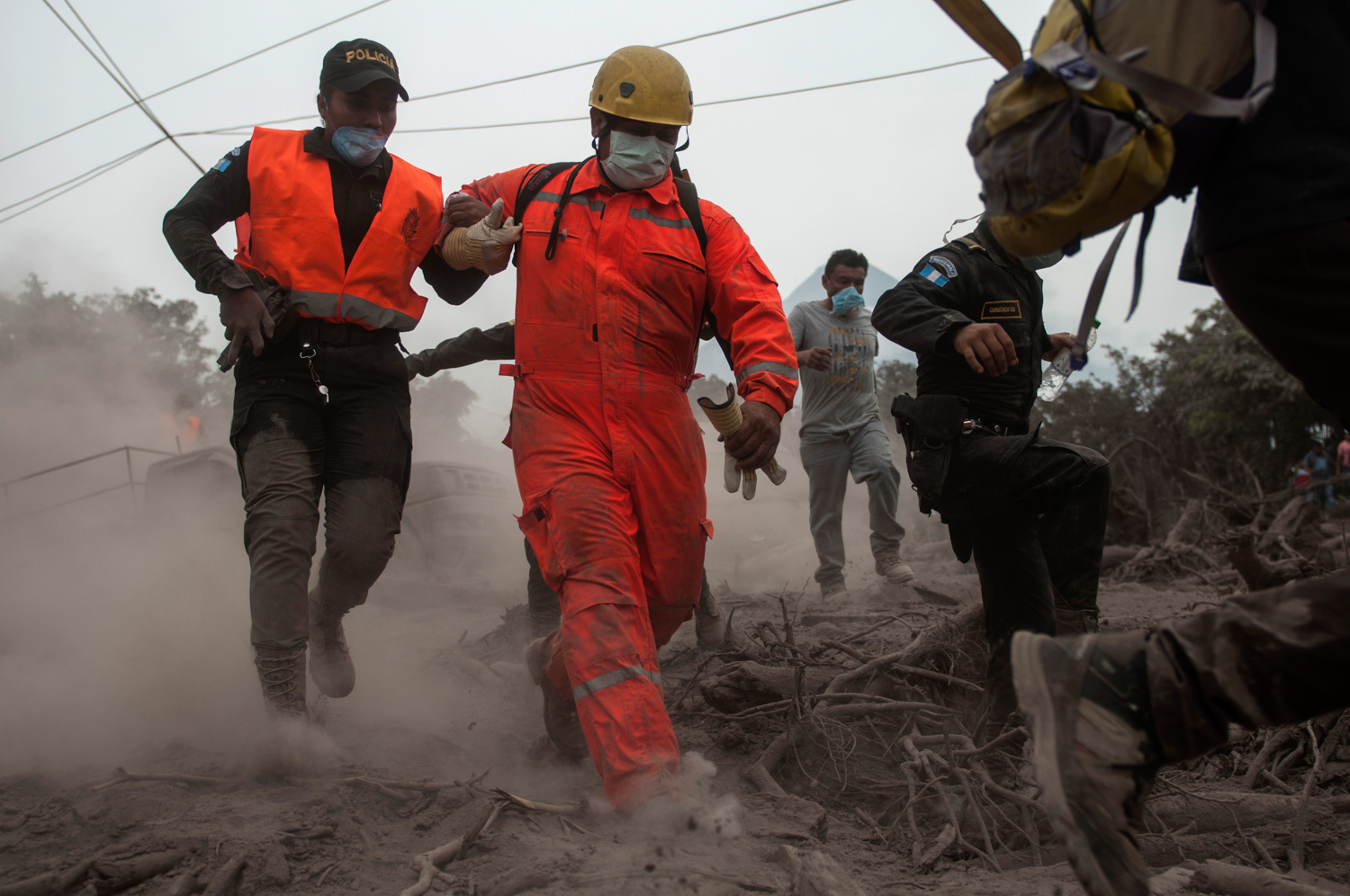 <div class='meta'><div class='origin-logo' data-origin='none'></div><span class='caption-text' data-credit='Oliver de Ros/AP Photo'>Firefighters and police are forced to evacuate a search and rescue effort as the Volcan de Fuego continues to spill out smoke and ash in Escuintla, Guatemala, Monday, June 4, 2018.</span></div>