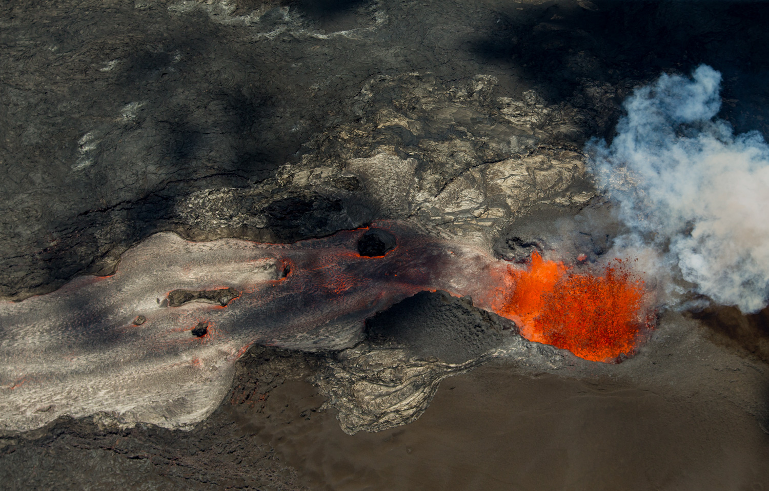 <div class='meta'><div class='origin-logo' data-origin='none'></div><span class='caption-text' data-credit='LE Baskow/AP Photo'>A fissure continues to blast lava several hundred feet in the air and flow towards Kapoho as the Kilauea Volcano lower east rift zone eruption continues on June 6, 2018, in Pahoa.</span></div>