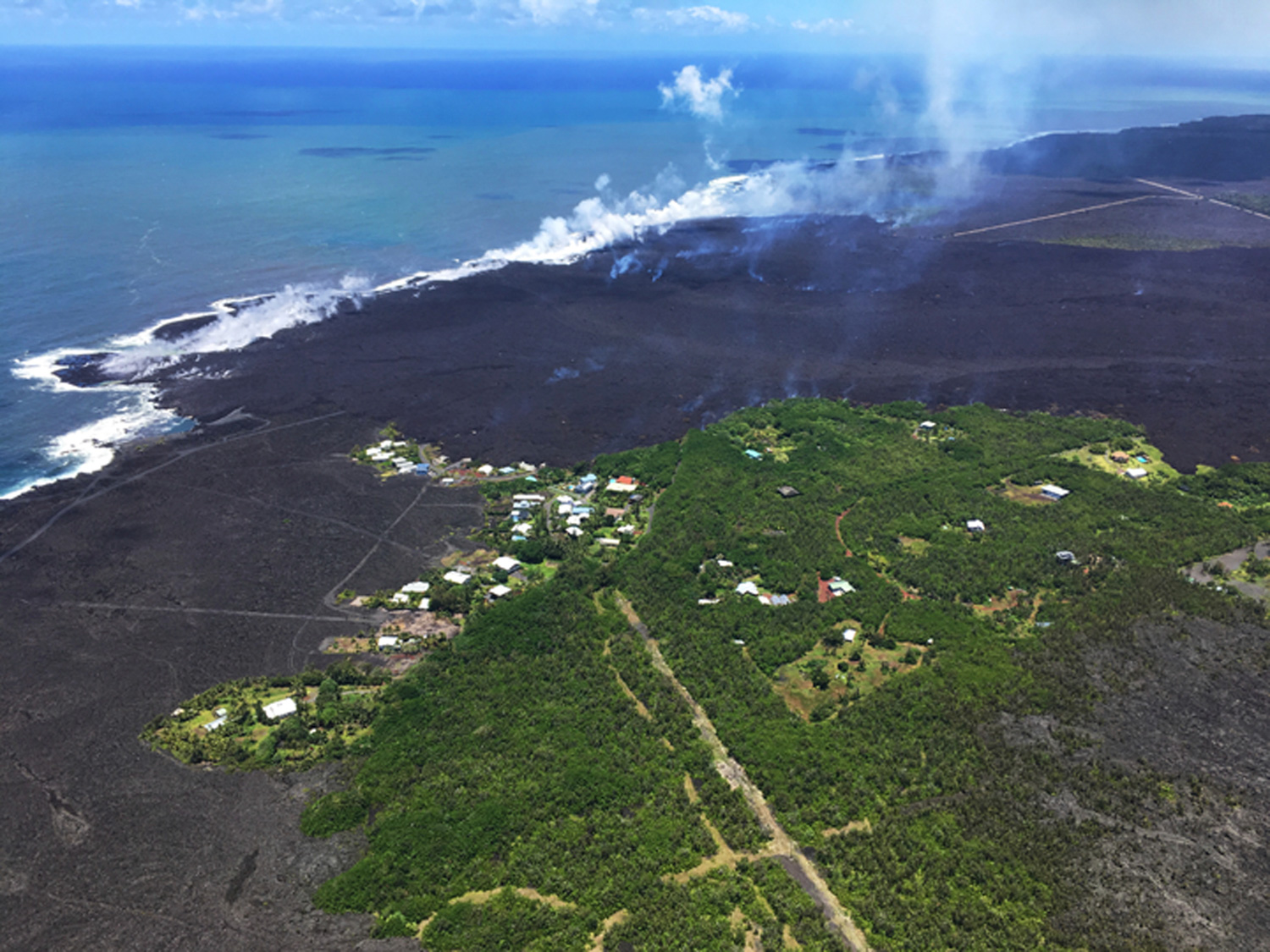 <div class='meta'><div class='origin-logo' data-origin='none'></div><span class='caption-text' data-credit='U.S. Geological Survey via AP'>The remains of the Kapoho Beach Lots subdivision and a fissure flow front at the town of Kapoho on the island of Hawaii.</span></div>