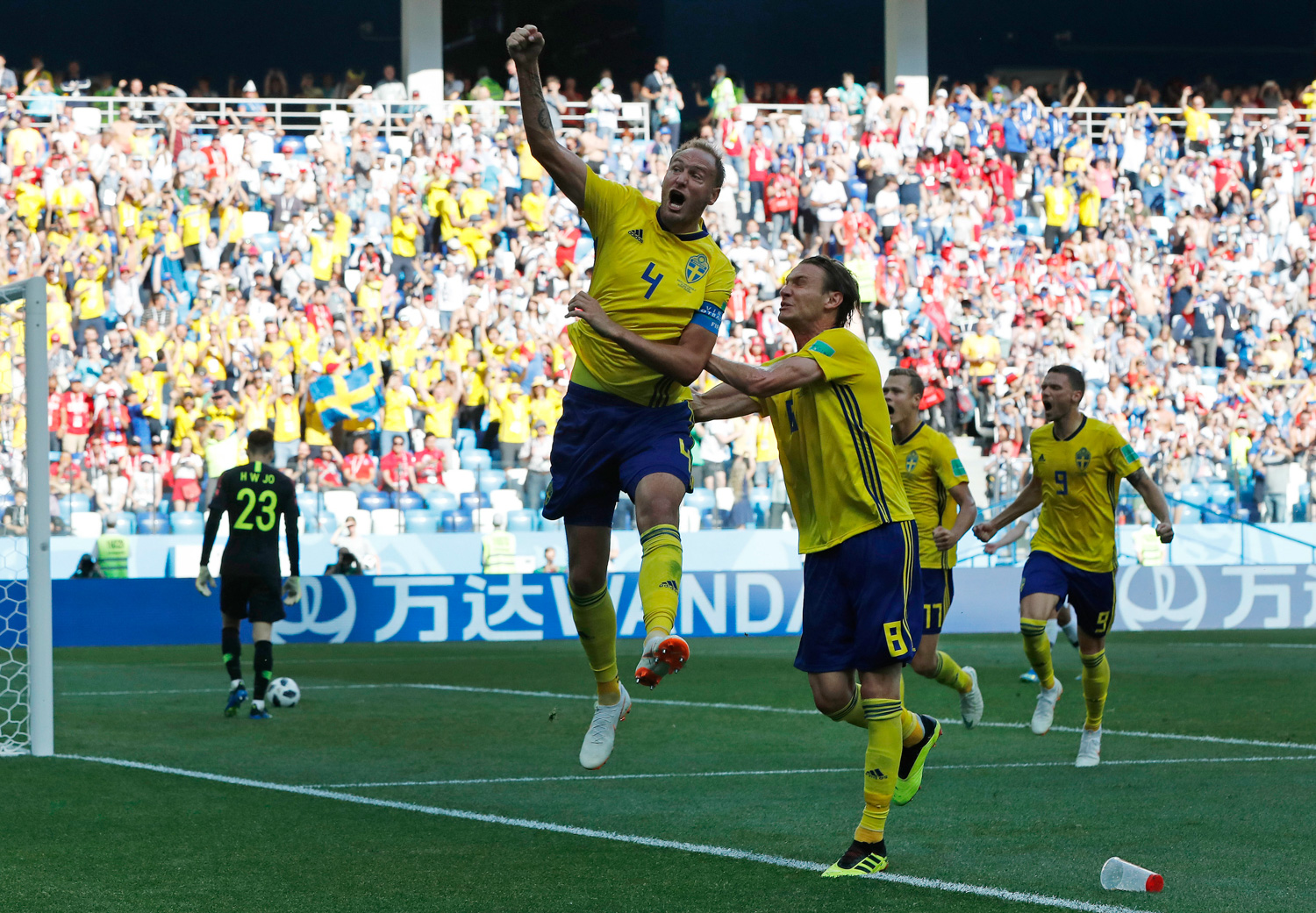 <div class='meta'><div class='origin-logo' data-origin='none'></div><span class='caption-text' data-credit='Pavel Golovkin/AP'>Sweden's Andreas Granqvist, centre, celebrates after scoring the opening goal during the group F match between Sweden and South Korea at the 2018 soccer World Cup</span></div>