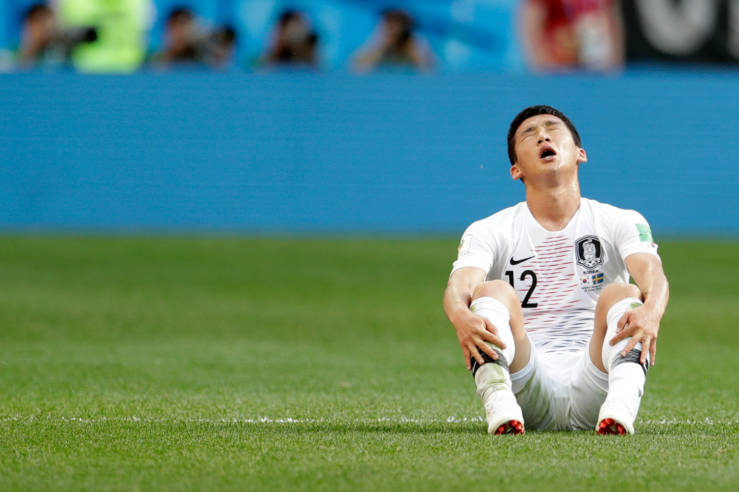 <div class='meta'><div class='origin-logo' data-origin='none'></div><span class='caption-text' data-credit='Petr David Josek/AP'>South Korea's Kim Min-woo sits on the pitch at the end of the group F match between Sweden and South Korea at the 2018 soccer World Cup in the Nizhny Novgorod stadium</span></div>