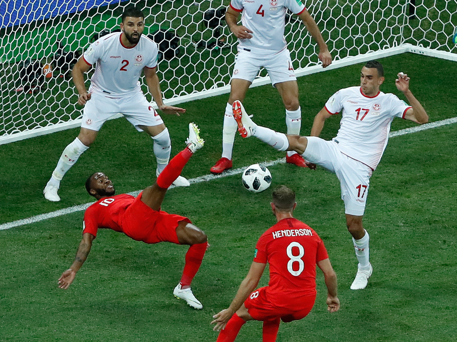 <div class='meta'><div class='origin-logo' data-origin='none'></div><span class='caption-text' data-credit='Rebecca Blackwell/AP Photo'>Tunisia's Ellyes Skhiri, right, and England's Raheem Sterling fight for the ball during the group G match between Tunisia and England</span></div>