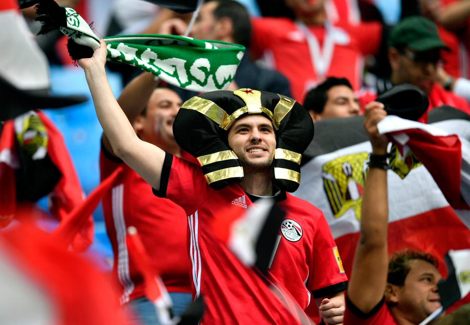 <div class='meta'><div class='origin-logo' data-origin='none'></div><span class='caption-text' data-credit='Martin Meissner/AP'>Supporters cheer prior the group A match between Russia and Egypt at the 2018 soccer World Cup in the St. Petersburg stadium</span></div>