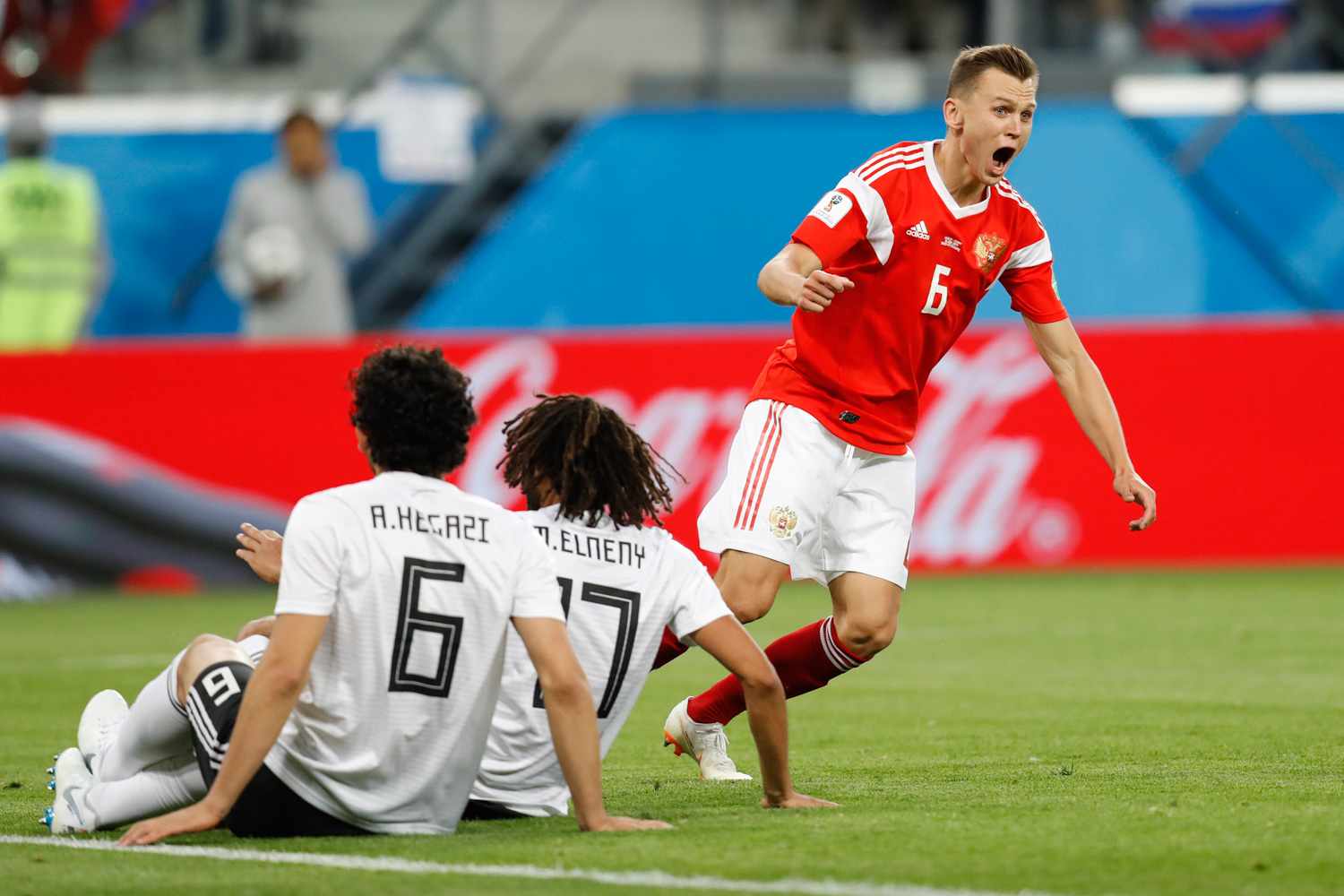 <div class='meta'><div class='origin-logo' data-origin='none'></div><span class='caption-text' data-credit='Efrem Lukatsky/AP'>Russia's Denis Cheryshev celebrates after scoring his team second goal during the group A match between Russia and Egypt at the 2018 soccer World Cup in the St. Petersburg stadium</span></div>