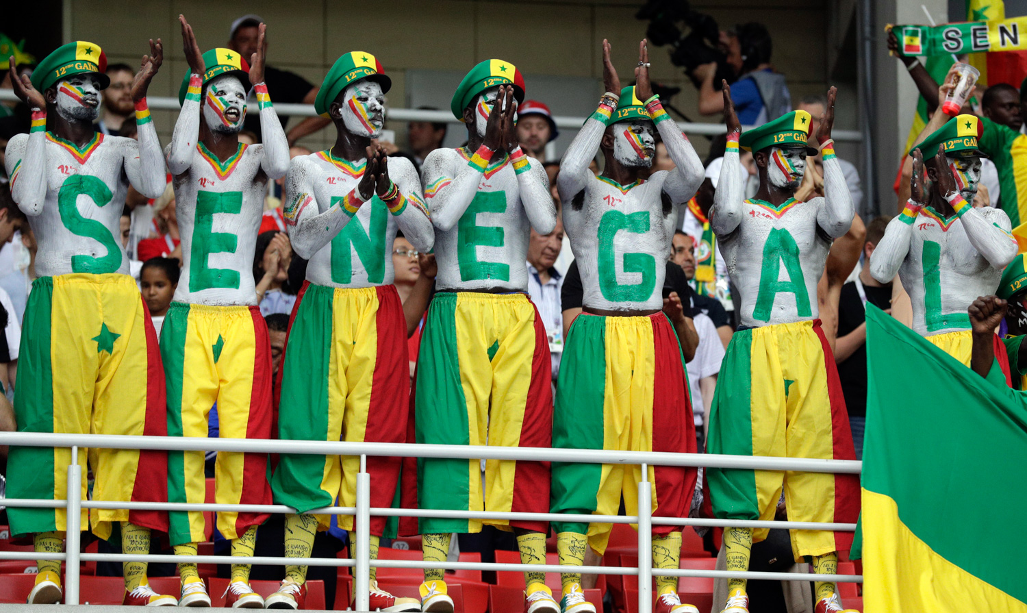<div class='meta'><div class='origin-logo' data-origin='none'></div><span class='caption-text' data-credit='Andrew Medichini/AP'>Senegal's fans, their bodies and faces painted in the colors of the national flag, support their team during the group H match between Poland and Senegal</span></div>