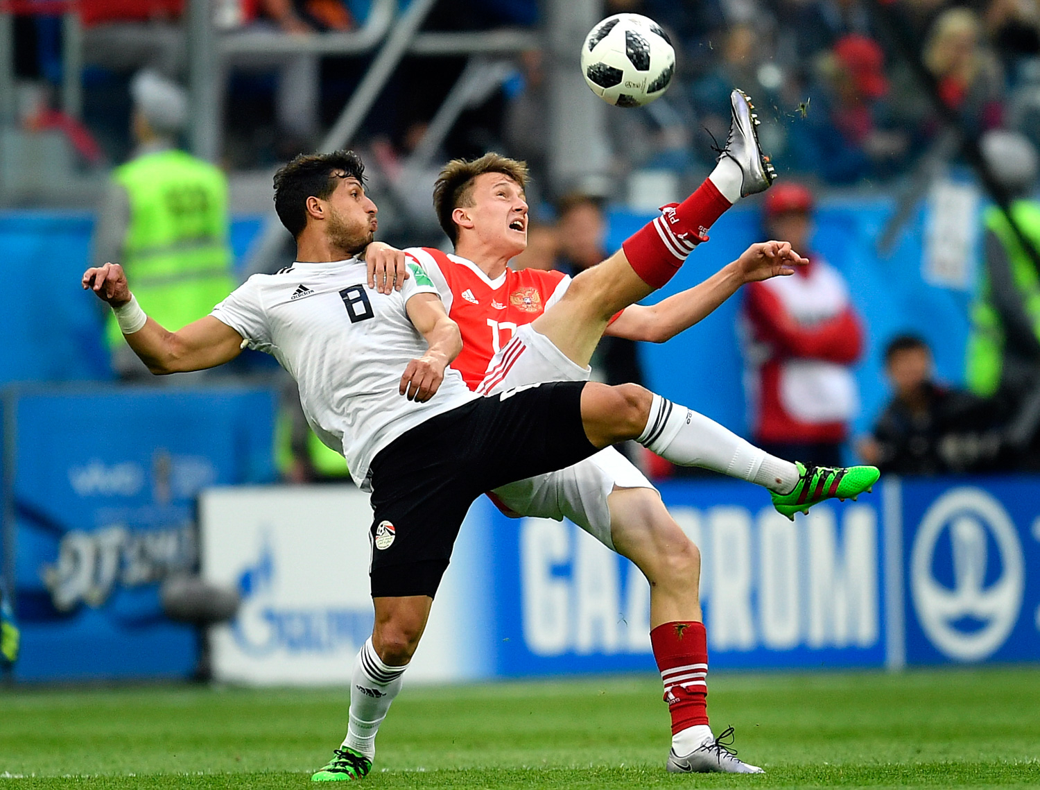 <div class='meta'><div class='origin-logo' data-origin='none'></div><span class='caption-text' data-credit='Martin Meissner/AP'>Egypt's Tarek Hamed, left, and Russia's Alexander Golovin compete for the ball during the group A match between Russia and Egypt</span></div>