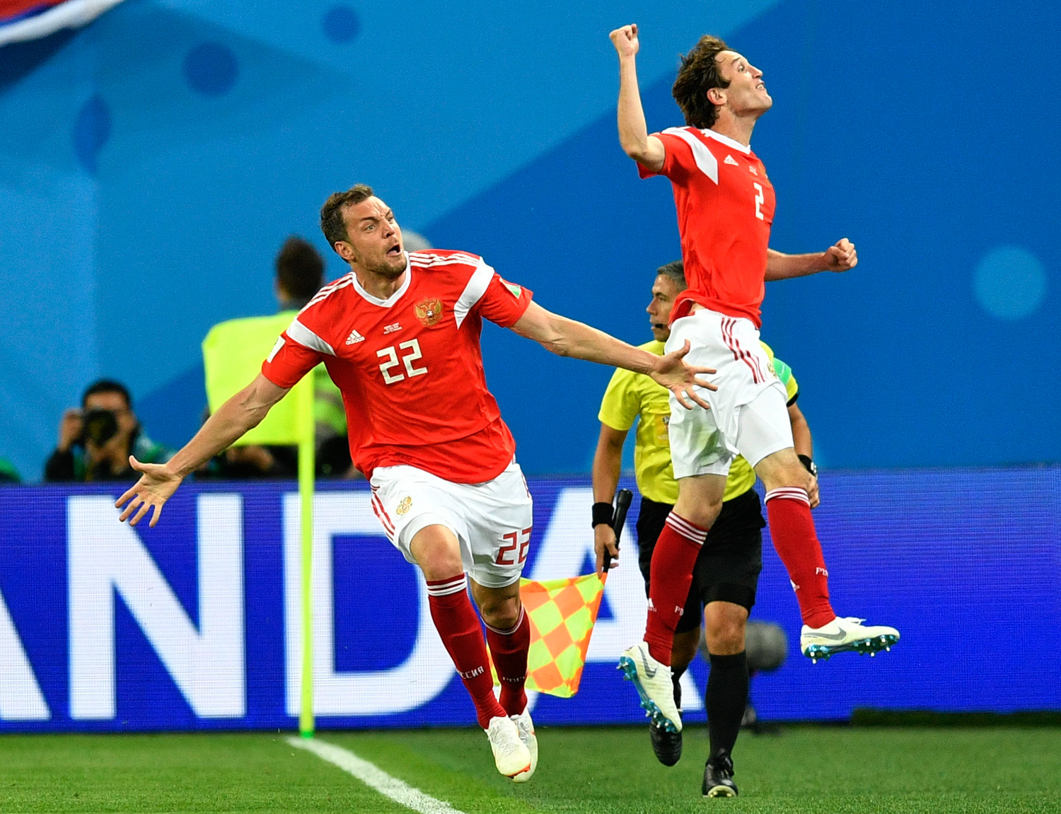 <div class='meta'><div class='origin-logo' data-origin='none'></div><span class='caption-text' data-credit='Martin Meissner/AP'>Russia's Artyom Dzyuba, left, celebrates with Russia's Mario Fernandes , right, after scoring his side's third goal during the group A match between Russia and Egypt</span></div>
