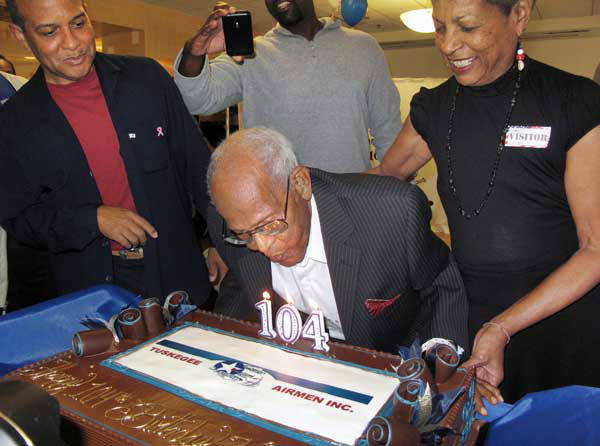"<div class=""meta image-caption""><div class=""origin-logo origin-image ""><span></span></div><span class=""caption-text"">Walter Crenshaw blows out the candles on his 104th birthday cake  The oldest living documented original Tuskegee Airmen member turned 104 on 10/27/13 (AP Photo/ HOEP)</span></div>"