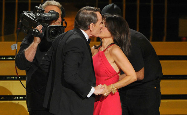 After Julia Louis-Dreyfus won the Emmy for  Outstanding Lead Actress in a Comedy Series, &#39;&#39;Breaking Bad&#39;&#39; star Bryan Cranston laid on a smooch that lasted 11 seconds. <span class=meta>(Photo&#47;Vince Bucci)</span>