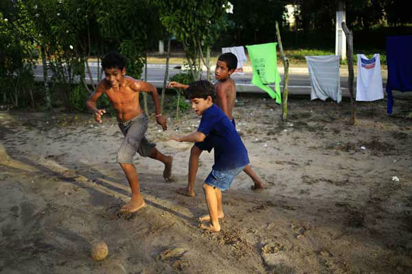 Children play soccer in front their homes in Tibau do Sul, near Natal, Brazil <span class=meta>AP Photo/ Hassan Ammar</span>