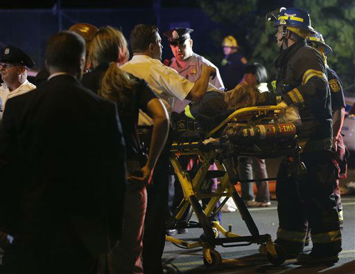 <div class='meta'><div class='origin-logo' data-origin='none'></div><span class='caption-text' data-credit='AP Photo/ Matt Slocum'>Emergency personnel transport a person at the scene of a train wreck, Tuesday, May 12, 2015, in Philadelphia.</span></div>
