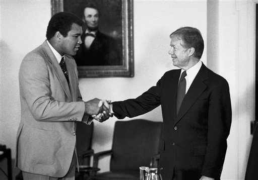 "<div class=""meta image-caption""><div class=""origin-logo origin-image none""><span>none</span></div><span class=""caption-text"">In this Monday, Feb. 11, 1980 file photo, retired heavyweight boxer Muhammad Ali, left, shakes hands with President Jimmy Carter. (AP Photo/Jim Wilson)</span></div>"