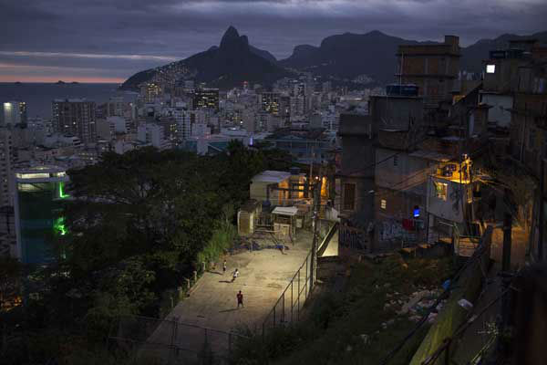 Kids play soccer at the Cantagalo slum in Rio de Janeiro, Brazil <span class=meta>AP Photo/ Felipe Dana</span>