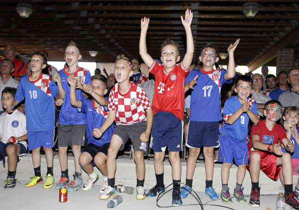 Children cheer for Croatia as they watch the world cup match between Croatia and Brazil at the Croatia Cleveland Soccer Club <span class=meta>(AP Photo&#47; Tony Dejak)</span>